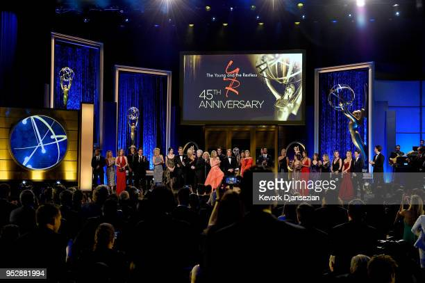 Cast and crew of 'The Young and the Restless' pay tribute to 45th Anniversary onstage during the 45th annual Daytime Emmy Awards at Pasadena Civic...