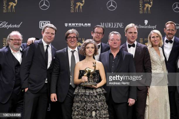 Cast and crew of 'TV Series of the Year' award winner Babylon Berlin pose with award during the 70th Bambi Awards winners board at Stage Theater on...
