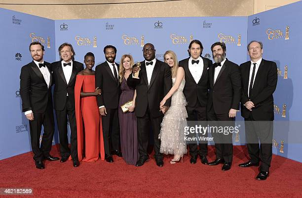 Cast and producers of '12 Years a Slave' winners of Best Motion Picture Drama pose in the press room during the 71st Annual Golden Globe Awards held...