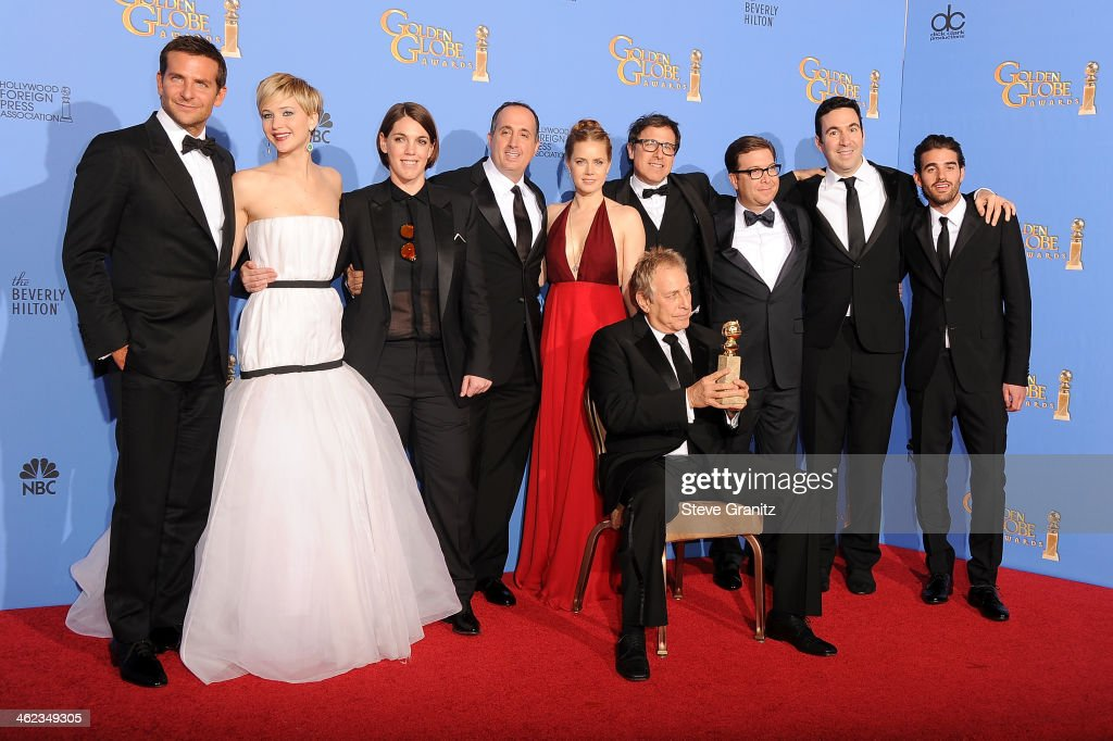 Cast and producers of 'American Hustle,' winners of Best Motion Picture - Musical or Comedy for 'American Hustle,' pose in the press room during the 71st Annual Golden Globe Awards held at The Beverly Hilton Hotel on January 12, 2014 in Beverly Hills, California.