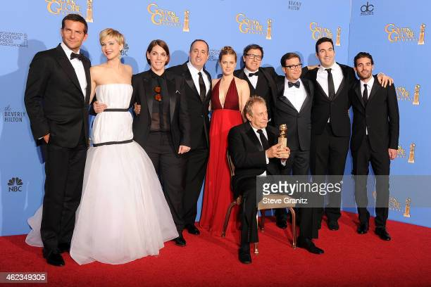 Cast and producers of 'American Hustle' winners of Best Motion Picture Musical or Comedy for 'American Hustle' pose in the press room during the 71st...