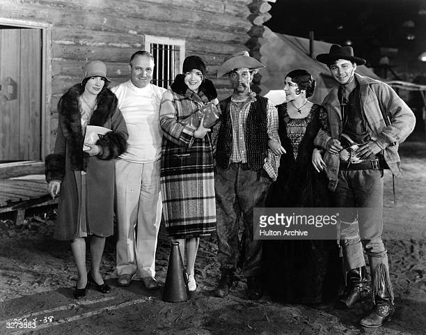 Cast and visitors on the set of 'The Tide Of Empire' directed by Allan Dwan LR Natalie Talmadge Keaton Allan Dwan Constance Talmadge Buster Keaton...
