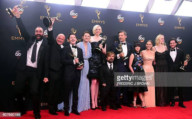 TOPSHOT Cast crew of 'Game of Thrones' pose with the Emmy for Outstanding Drama Series in the press room during the 68th Emmy Awards on September 18...