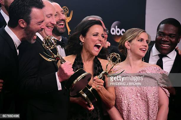 Cast & crew of 'Veep' pose with the Emmy for Outstanding Comedy Series, in the press room during the 68th Emmy Awards on September 18, 2016 at the...