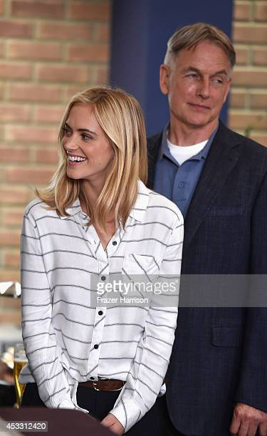 NCIS cast Emily Wickersham and Mark Harmon celebrate 'NCIS' being named he mostwatched drama in the World after receiving the International TV...