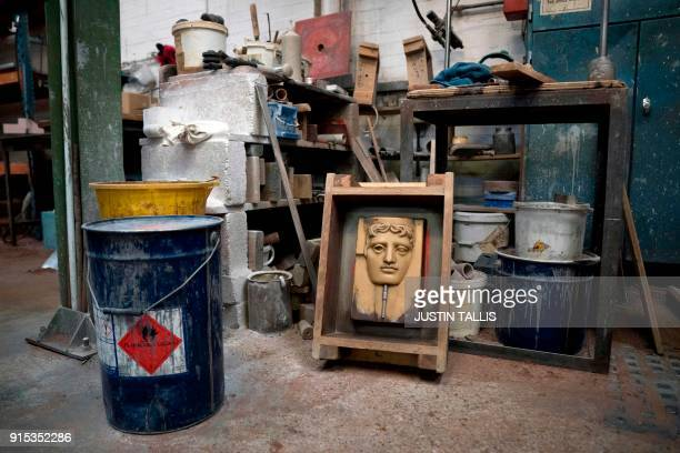 A cast for a BAFTA mask is pictured during a photo call at the New Pro Foundries west of London on February 7 2018 ahead of the British Academy Film...