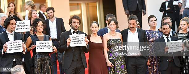 Cast from the Brazilian film 'Aquarius' hold placards protesting against the current political landscape in Brazil after the screening of the film...