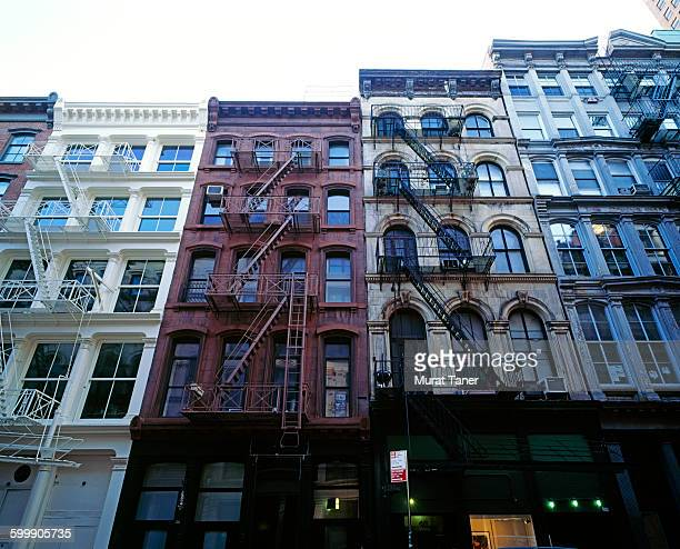 cast iron buildings in the soho district - soho new york stock photos and pictures