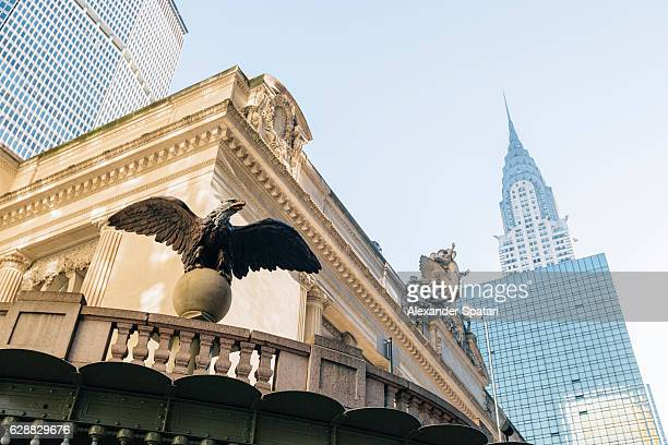 cast iron eagle statue at grand central terminal, new york city, ny, usa - grand central station stock photos and pictures