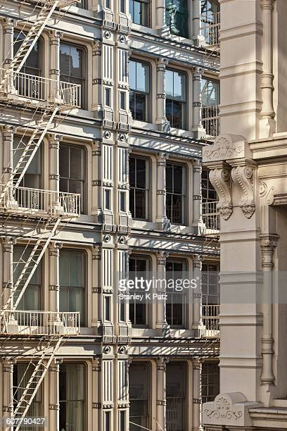 cast iron facades in soho - soho new york stock pictures, royalty-free photos & images