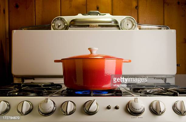 cast iron pot on stove - cooking pan stock pictures, royalty-free photos & images