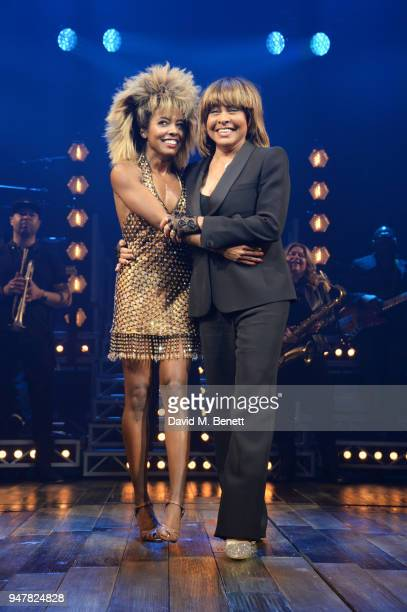 Cast member Adrienne Warren and Tina Turner bow at the curtain call during the press night performance of 'Tina The Tina Turner Musical' at the...