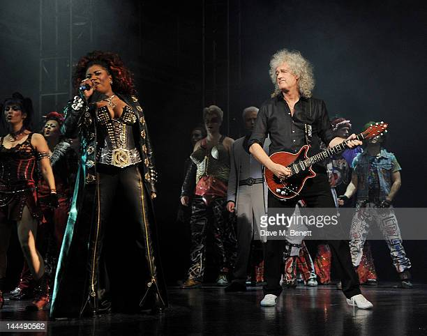 Cast member Brenda Edwards and Queen guitarist Brian May perform during the We Will Rock You 10 Year Anniversary Celebration performance at The...