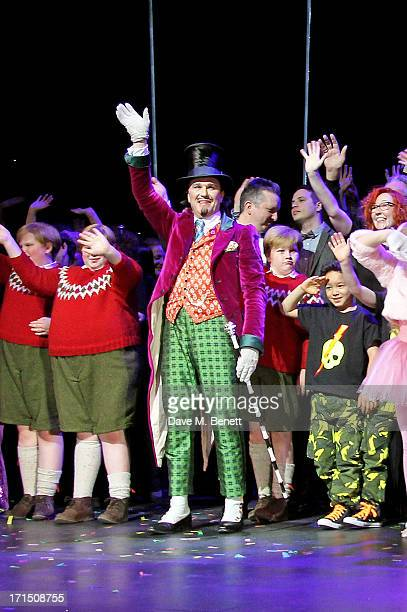 Cast member Douglas Hodge and cast bow at the curtain call during the press night performance of 'Charlie And The Chocolate Factory' at the Theatre...