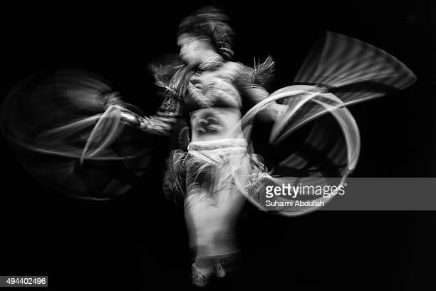 A cast member from Cirque du Soleil performs on stage during a preview of the Cirque du Soleil TOTEM at Marina Bay Sands on October 27 2015 in...