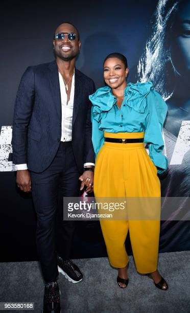 Cast member Gabrielle Union and her husband basketball player for the Miami Heat Dwyane Wade arrive for Universal Pictures' special screening of the...