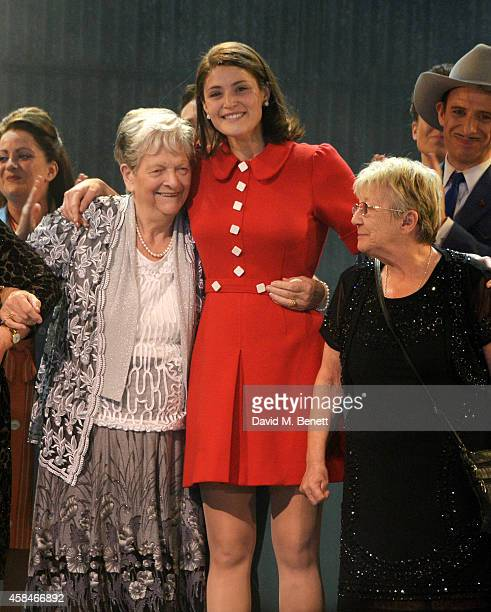 Cast member Gemma Arterton and reallife Dagenham strikers Eileen Pullen and Vera Sime bow at the curtain call during the press night performance of...
