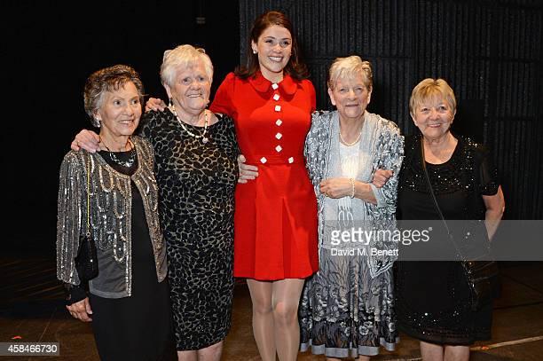 Cast member Gemma Arterton poses with reallife Dagenham strikers Gwen Davis Eileen Pullen Vera Sime and Sheila Douglass backstage during the press...