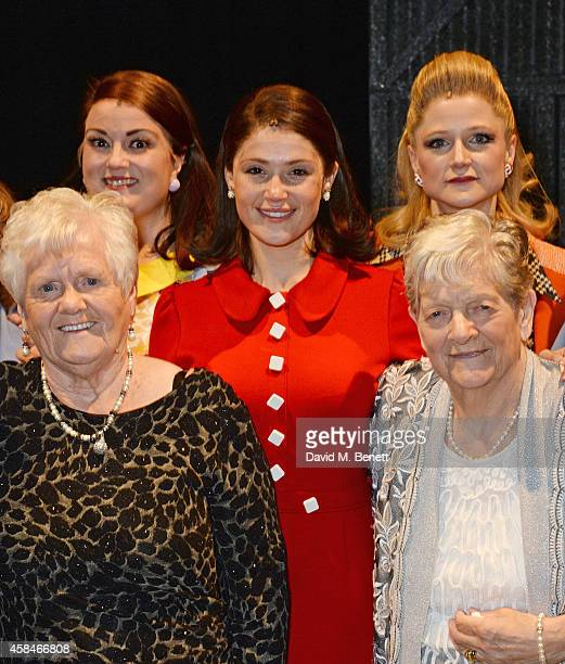 Cast member Gemma Arterton poses with the ladies of the Made In Dagenham company and reallife Dagenham strikers Eileen Pullen and Vera Sime backstage...