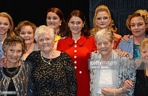 Cast member Gemma Arterton poses with the ladies of the Made In Dagenham company and reallife Dagenham strikers Gwen Davis Eileen Pullen and Vera...
