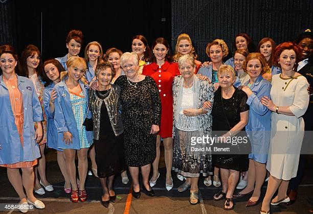 Cast member Gemma Arterton poses with the ladies of the Made In Dagenham company and reallife Dagenham strikers Gwen Davis Eileen Pullen Vera Sime...