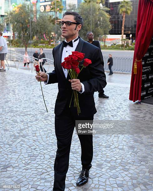 A cast member hands out roses to female fans during a special outdoor performance of Zumanity The Sensual Side of Cirque du Soleil at the New YorkNew...