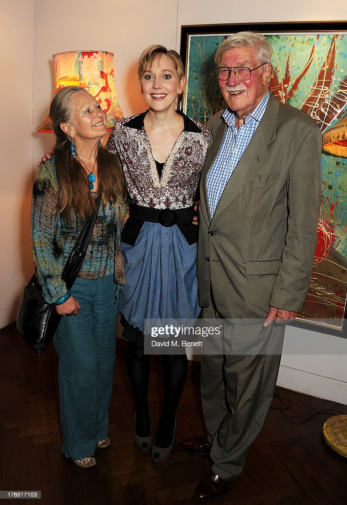 Cast member Hattie Morahan (C) with parents Anna Carteret (L) and Christopher Morahan attend an after party following the press night performance of 'A Doll's House' at The Hospital Club on August 14, 2013 in London, England.