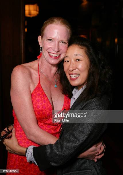 Cast member Johanna Day and actress Sandra Oh pose during the party for the opening night performance of 'Poor Behavior' at Center Theatre Group's...
