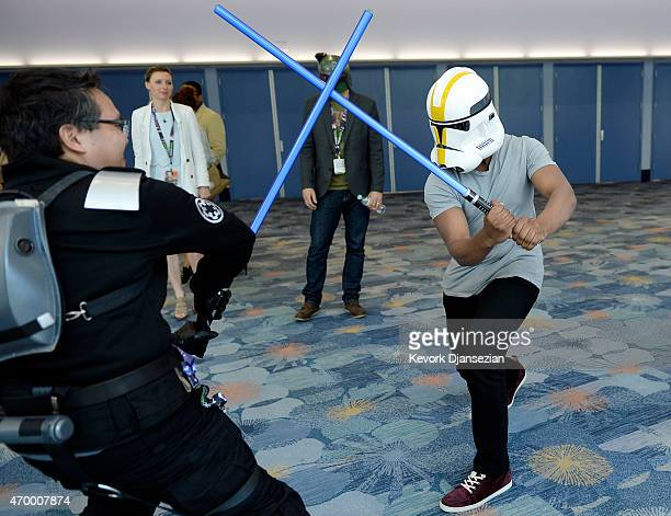 Cast member John Boyega of the film Star Wars The Force Awakens wearing a Stormtrooper helmet to disguise his identity engages a unknowing fan in a...