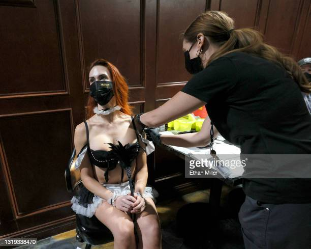 """Cast member JoJo Hamner from the """"Sexxy After Dark by Jennifer Romas"""" show receives the Pfizer-BioNTech vaccine from Southern Nevada Health District..."""
