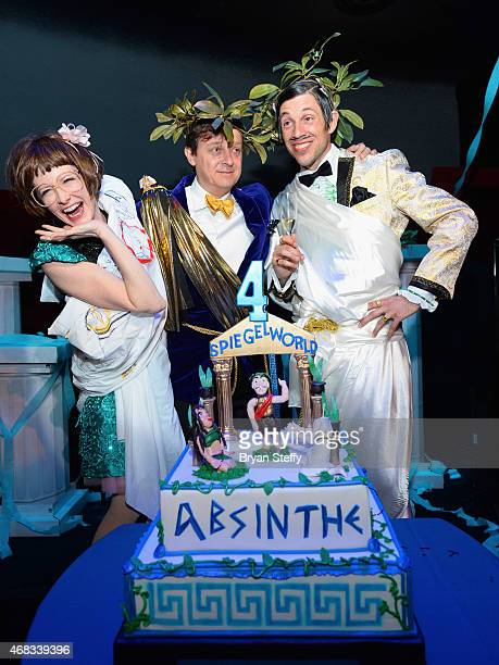 'ABSINTHE' cast member Joy Jenkins producer Ross Mollison and cast member The Gazillionaire attend the show's fourth anniversary party at Caesars...