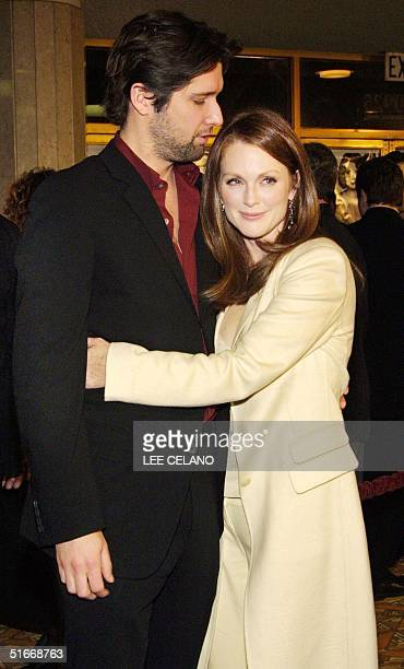 Cast member Julianne Moore hugs her husband John Gould Rubin after arriving for the premiere of the film The Hours 18 December 2002 in the Westwood...