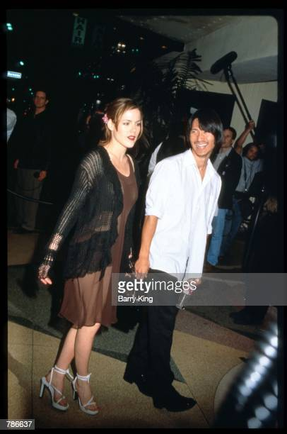 Cast member Kathleen Robertson attends the 'Beverly Hills 90210' wrap party with her boyfriend Greg Araki at April 17 1997 in Los Angeles CA Cast and...