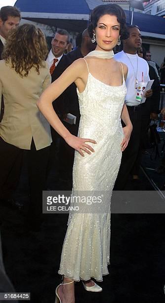 Cast member Lara Flynn Boyle arrives for the premiere of Men in Black II 26 June 2002 in the Westwood area of Los Angeles AFP PHOTO/Lee Celano