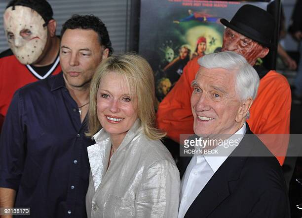 Cast member Leslie Nielsen arrives with his wife Barbaree Earl Nielsen at the premiere of the horror film parody Stan Helsing in the Hollywood...