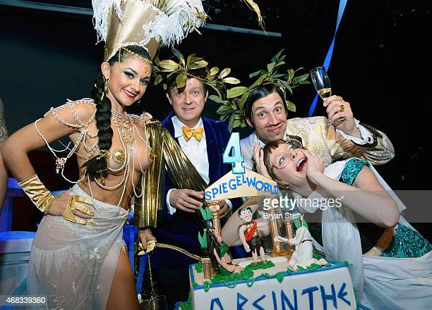 ABSINTHE cast member Melody Sweets producer Ross Mollison and cast members The Gazillionaire and Joy Jenkins attend the show's fourth anniversary...