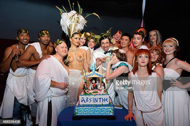 'ABSINTHE' cast member Melody Sweets producer Ross Mollison cast members The Gazillionaire and Joy Jenkins appear with ABSINTHE cast members during...