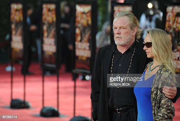 Cast member Nick Nolte and a guest arrive at the Los Angeles premiere of Dreamworks' Tropic Thunder in Los Angeles California on Aug 11 2008 AFP...
