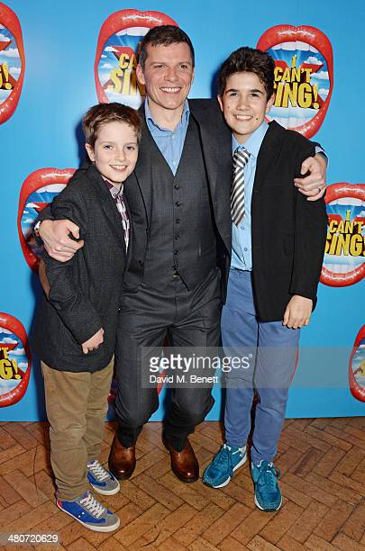 Cast member Nigel Harman poses with young cast members Noah Key and Finlay Banks at the after party following the press night performance of 'I Can't...