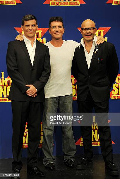 Cast member Nigel Harman Simon Cowell and writer Harry Hill pose at a photocall to launch I Can't Sing The X Factor Musical at RADA on September 2...