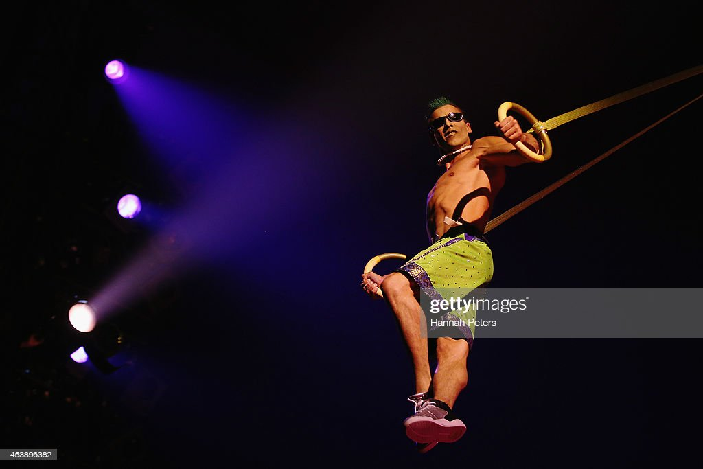 Cast members of Cirque Du Soleil TOTEM perform during