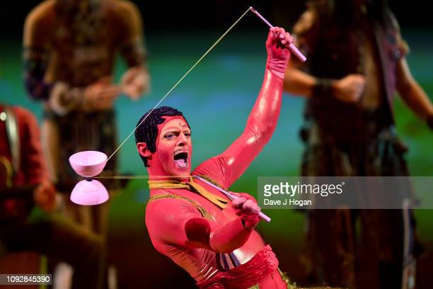 A cast member of Cirque Du Soleil TOTEM performs as the Tracker transformed into a Toreador during the Diabolo act during a dress rehearsal at Royal...