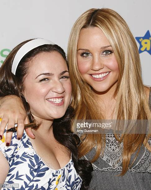 Cast member of Hairspray Nikki Blonsky and Amanda Bynes introduce a new line of Hairspray dolls at Toys R Us at Times Square on July 17 2007 in New...