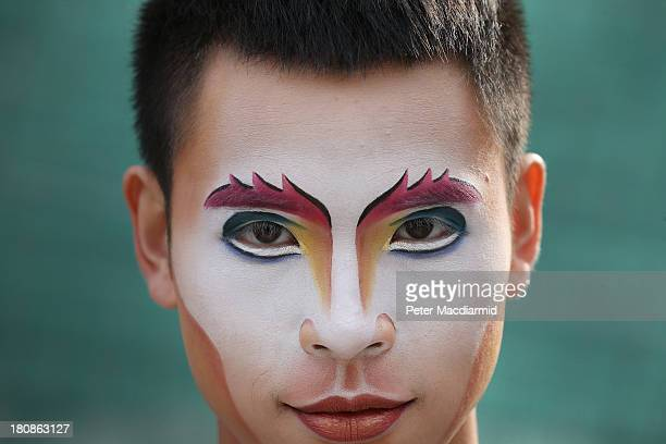 A cast member of Quidam from Cirque de Soleil poses outside the Royal Albert Hall on September 17 2013 in London England Quidam a story of a bored...