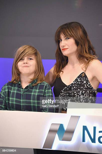 Cast member of the film Bad Moms Kathryn Hahn with son Leonard Sandler ring the closing bell at NASDAQ on July 28 2016 in New York City