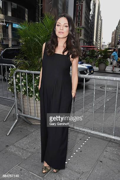 Cast member of the film 'Bad Moms' Mila Kunis poses for a picture after ringing the closing bell at NASDAQ on July 28 2016 in New York City