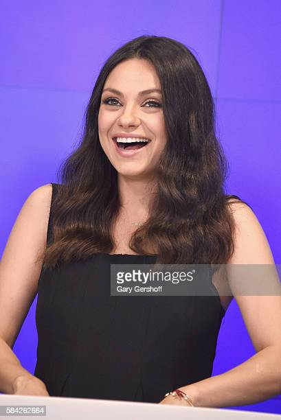 Cast member of the film 'Bad Moms' Mila Kunis rings the closing bell at NASDAQ on July 28 2016 in New York City