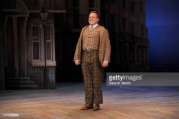 Cast member Owain Arthur bows at the curtain call during the press night performance of 'One Man Two Guvnors' as it transfers to the Theatre Royal...