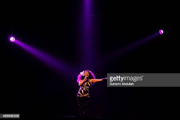 A cast member performs on stage during the opening of Saturday Night Fever The Musical at the Mastercard Theatre Marina Bay Sands on September 25...