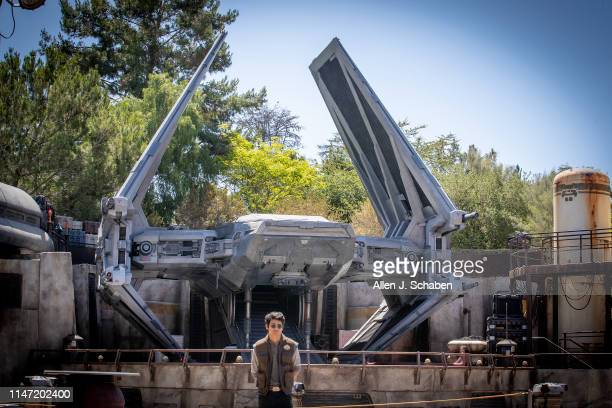 ANAHEIM CALIF WEDNESDAY MAY 29 2019 A cast member stands guard atl The First Order Outpost where the Tie Echelon fighter ship is parked as media...